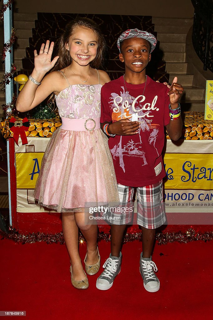 Actors Caitlin Carmichael (L) and Wilbur Wiggins arrive at A Country Christmas VIP screening hosted by miss Caitlin Carmichael to benefit Alex's Lemonade Stand on November 12, 2013 in Los Angeles, California.
