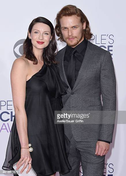 Actors Caitriona Balfe and Sam Heughan arrive at The 41st Annual People's Choice Awards at Nokia Theatre LA Live on January 7 2015 in Los Angeles...