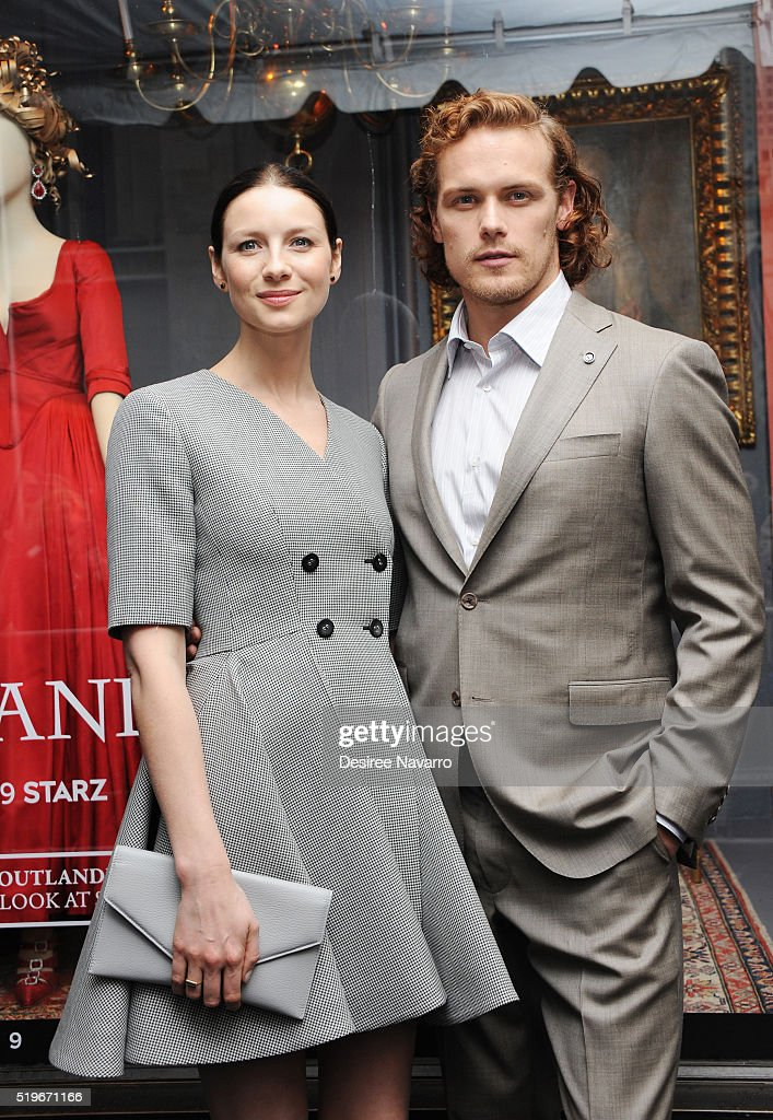 Actors Caitriona Balfe and Sam Heughan attend Saks Fifth Avenue 'Outlander' Window Display Unveiling at Saks Fifth Avenue on April 7, 2016 in New York City.