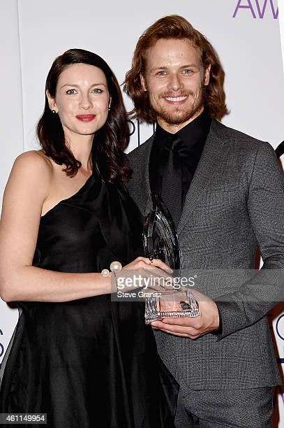 Actors Caitriona Balfe and Sam Heughan pose in the press room at the 41st Annual People's Choice Awards at Nokia Theatre LA Live on January 7 2015 in...