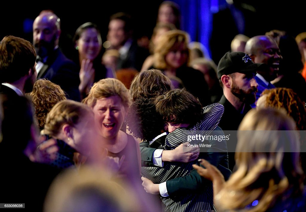 Actors Caleb McLaughlin, Finn Wolfhard and Gaten Matarazzo of 'Stranger Things' embrace after winning Outstanding Performance by an Ensemble in a Drama Series onstage during The 23rd Annual Screen Actors Guild Awards at The Shrine Auditorium on January 29, 2017 in Los Angeles, California. 26592_014