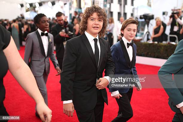 Actors Caleb McLaughlin Gaten Matarazzo and Noah Schnapp attend The 23rd Annual Screen Actors Guild Awards at The Shrine Auditorium on January 29...