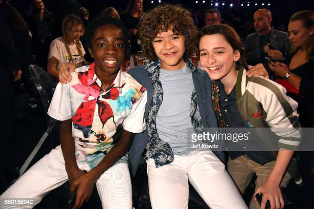Actors Caleb McLaughlin Gaten Matarazzo and Noah Schnapp attend the 2017 MTV Movie And TV Awards at The Shrine Auditorium on May 7 2017 in Los...