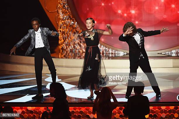 Actors Caleb McLaughlin Millie Bobby Brown and Gaten Matarazzo perform onstage during the 68th Annual Primetime Emmy Awards at Microsoft Theater on...