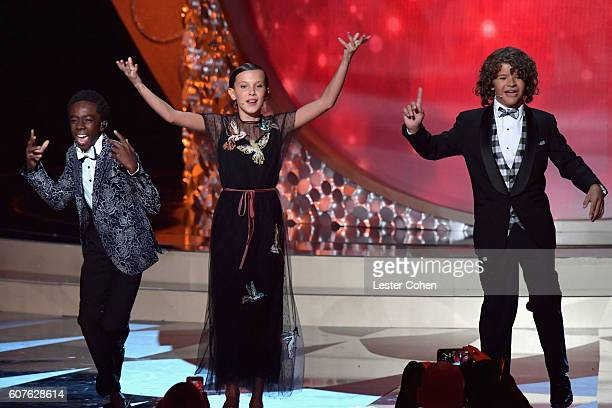 Actors Caleb McLaughlin Millie Bobby Brown and Gaten Matarazzo perform onstage during the preshow before the 68th Annual Primetime Emmy Awards at...