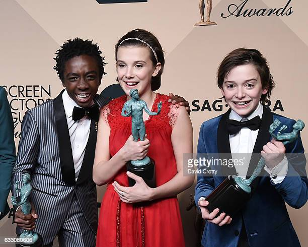 Actors Caleb McLaughlin Millie Bobby Brown and Noah Schapp winners of the Outstanding Ensemble in a Drama Series award for 'Stranger Things' pose in...