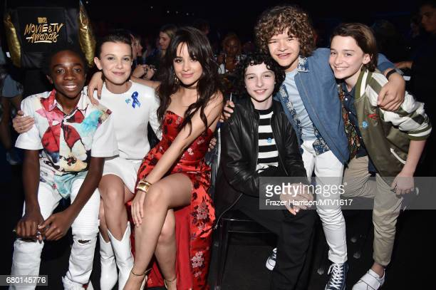 Actors Caleb McLaughlin Millie Bobby Brown singer Camila Cabello and actors Finn Wolfhard Gaten Matarazzo and Noah Schnapp attend the 2017 MTV Movie...
