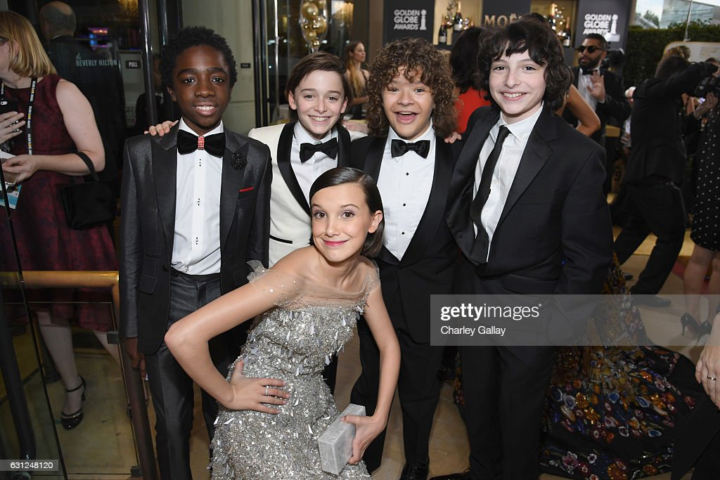 Actors Caleb McLaughlin, Noah Schnapp, Gaten Matarazzo, Finn Wolfhard, and (bottom) Millie Bobby Brown at the 74th annual Golden Globe Awards sponsored by FIJI Water at The Beverly Hilton Hotel on January 8, 2017 in Beverly Hills, California.