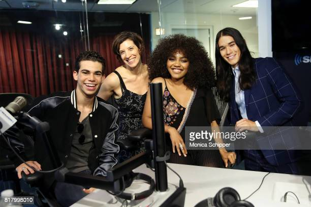 Actors Cameron Boyce China Anne McClain and Booboo Stewart pose for a photo with Entertainment Weekly radio host Jessica Shaw when they visit...