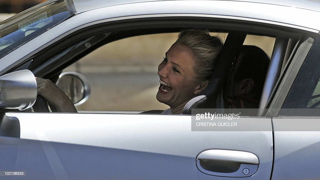 US actors Cameron Diaz drives a car to recreate scenes from the film 'Knight and Day' by US director James Mangold in Sevilla on June 16, 2010. US actors Tom Cruise and Cameron Diaz are in Sevilla to attend the international premiere of Mangold's new film.