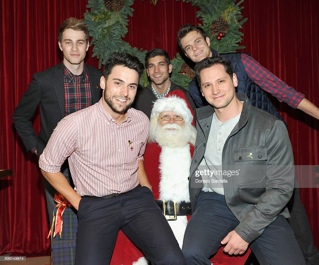 Actors Cameron Fuller, David Bernon and Jack Quaid, (bottom L-R) Actors Jack Falahee and Matt McGorry pose with Santa Claus at the Brooks Brothers holiday party with St Jude Children's Research Hospital at Brooks Brothers on Rodeo Drive on December 5, 2015 in Beverly Hills, California.