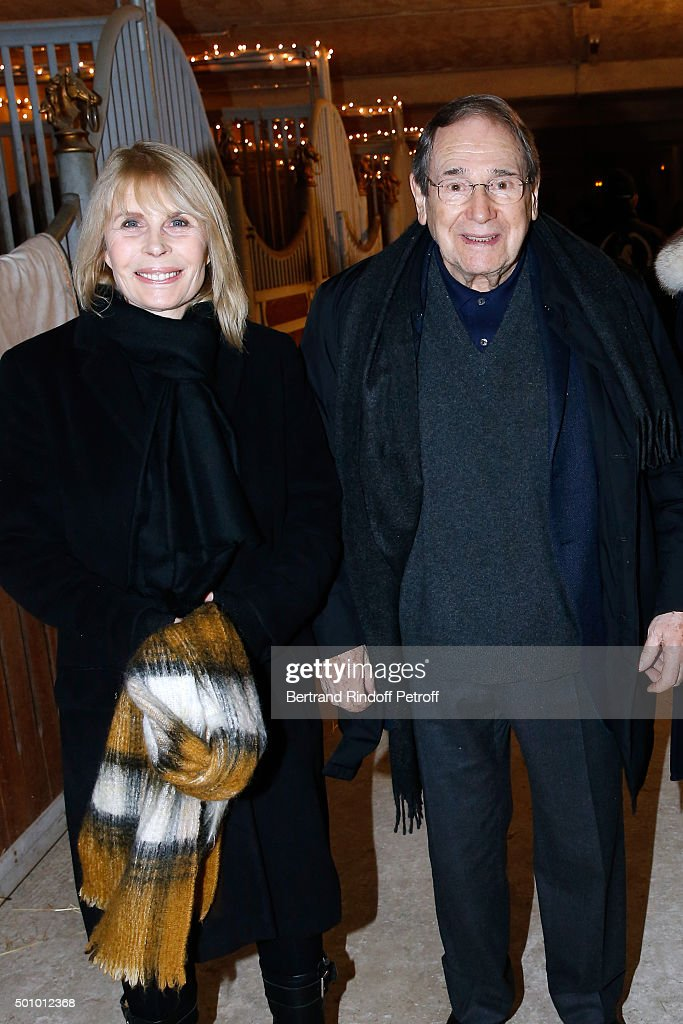 Actors Candice Patou and her husband <a gi-track='captionPersonalityLinkClicked' href=/galleries/search?phrase=Robert+Hossein&family=editorial&specificpeople=1368725 ng-click='$event.stopPropagation()'>Robert Hossein</a> attend the 'Mario Luraschi's Espace Cavalcade' : Opening Night at Ferme De La Chapelle on December 11, 2015 in Ermenonville, near Paris, France.