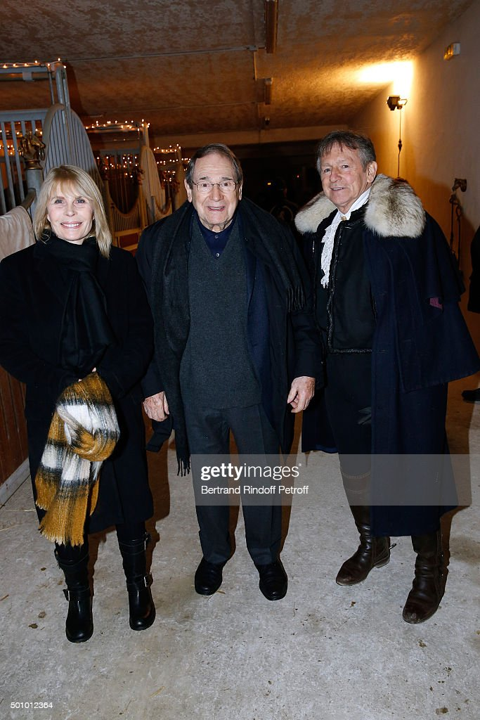 Actors Candice Patou, her husband <a gi-track='captionPersonalityLinkClicked' href=/galleries/search?phrase=Robert+Hossein&family=editorial&specificpeople=1368725 ng-click='$event.stopPropagation()'>Robert Hossein</a> and Mario Luraschi attend the 'Mario Luraschi's Espace Cavalcade' : Opening Night at Ferme De La Chapelle on December 11, 2015 in Ermenonville, near Paris, France.