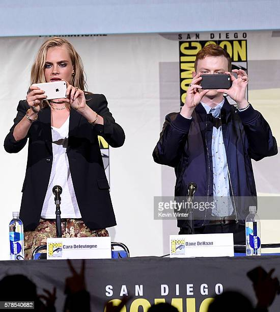 Actors Cara Delevingne and Dane DeHaan take photos at the 'Valerian And The City Of A Thousand Planets' panel during ComicCon International 2016 at...