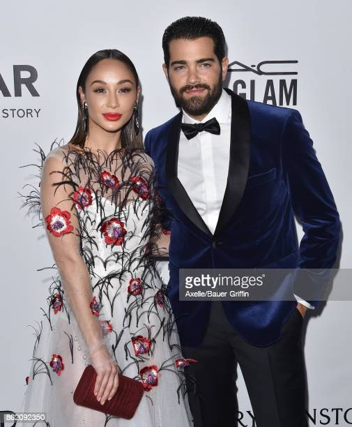 Actors Cara Santana and Jesse Metcalfe arrive at amfAR Los Angeles 2017 at Ron Burkle's Green Acres Estate on October 13 2017 in Beverly Hills...