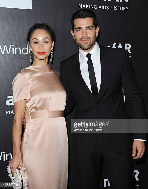 Actors Cara Santana and Jesse Metcalfe arrive at the 2014 amfAR LA Inspiration Gala at Milk Studios on October 29 2014 in Hollywood California