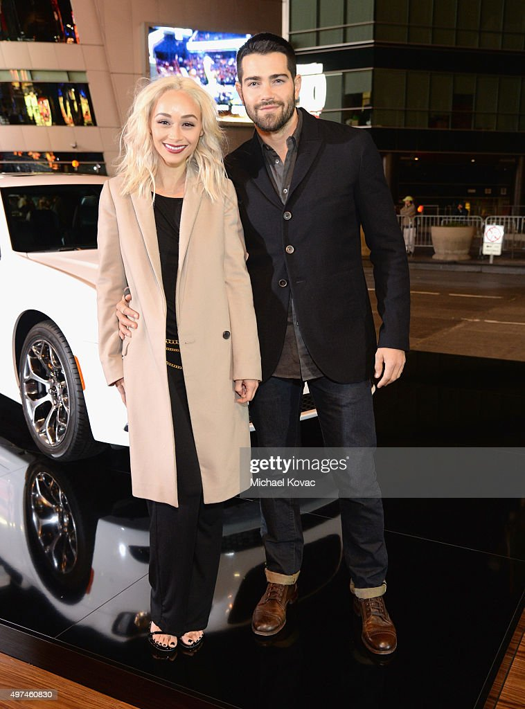 Actors Cara Santana (L) and Jesse Metcalfe attend 'Hunger Games: Mockingjay Part 2' Los Angeles Premiere Sponsored By Chrysler on November 16, 2015 in Los Angeles, California.