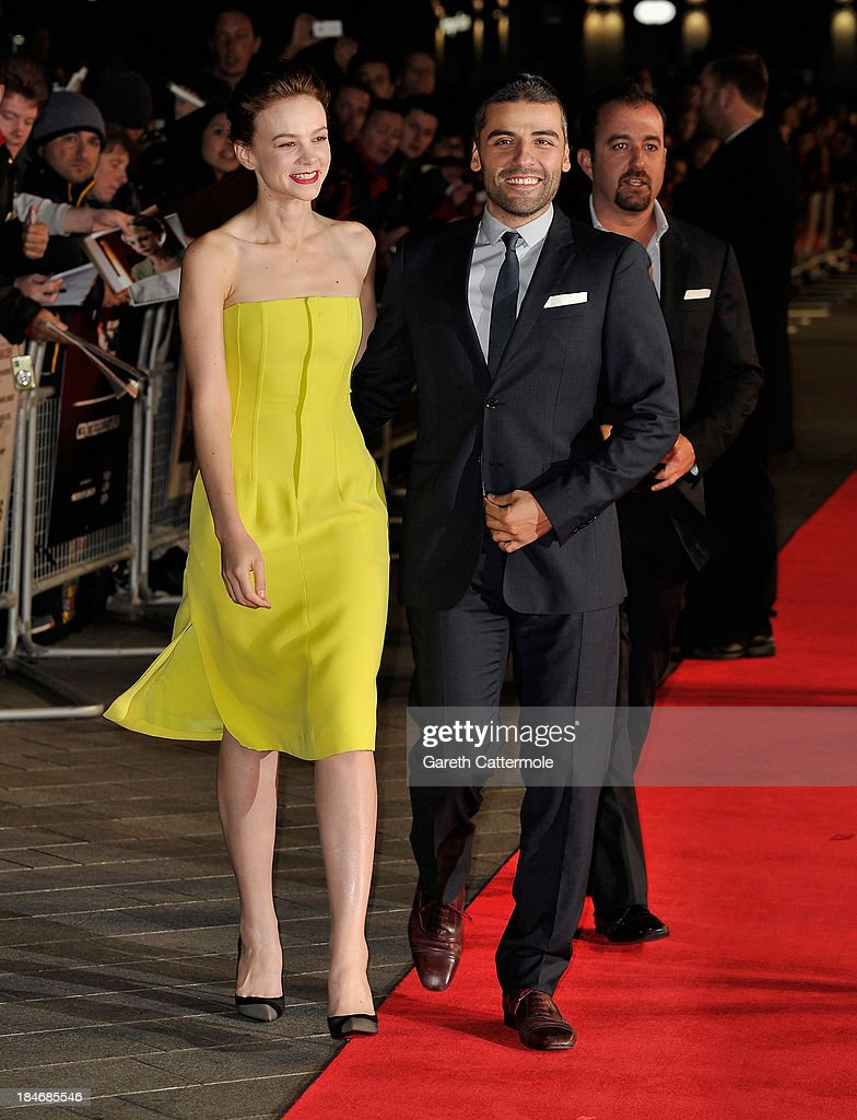 Actors Carey Mulligan and Oscar Isaac attend the 'Inside Llewyn Davis' Centrepiece Gala Supported By The Mayor Of London screening during the 57th BFI London Film Festival at Odeon Leicester Square on October 15, 2013 in London, England.