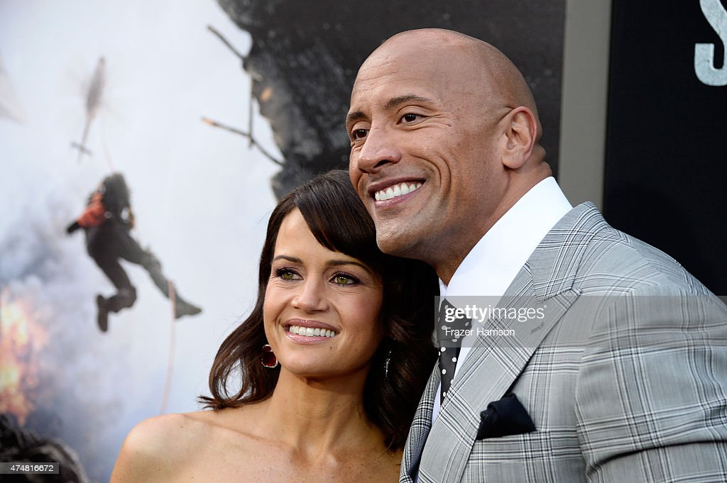 Actors Carla Gugino (L) and Dwayne 'The Rock' Johnson attend the premiere of Warner Bros. Pictures' 'San Andreas' at the TCL Chinese Theatre on May 26, 2015 in Hollywood, California.