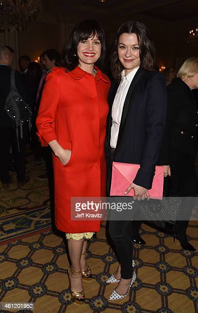 Actors Carla Gugino and Maribeth Monroe wait in the lobby after 'The Brink' panel as part of the 2015 HBO Winter Television Critics Association press...