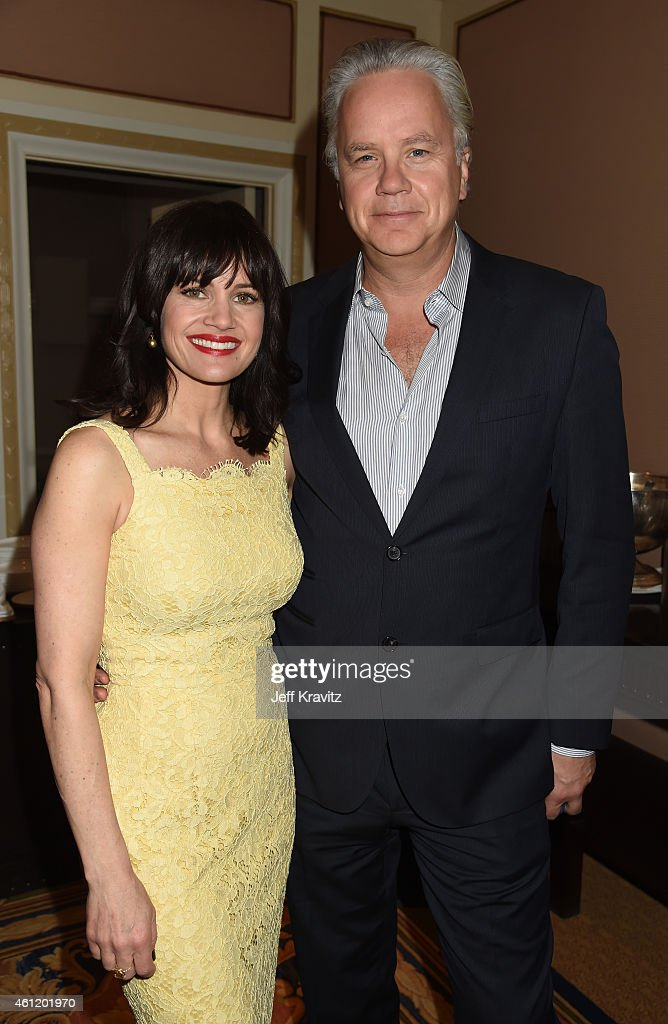 Actors Carla Gugino and Tim Robbins wait in the lobby after 'The Brink' panel as part of the 2015 HBO Winter Television Critics Association press...