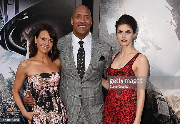 Actors Carla Gugino Dwayne 'The Rock' Johnson and Alexandra Daddario attend the 'San Andreas' Los Angeles Premiere at TCL Chinese Theatre IMAX on May...