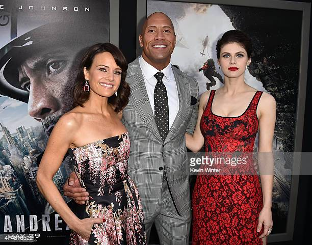 Actors Carla Gugino Dwayne 'The Rock' Johnson and Alexandra Daddario arrive at the premiere of Warner Bros Pictures' 'San Andreas' at TCL Chinese...