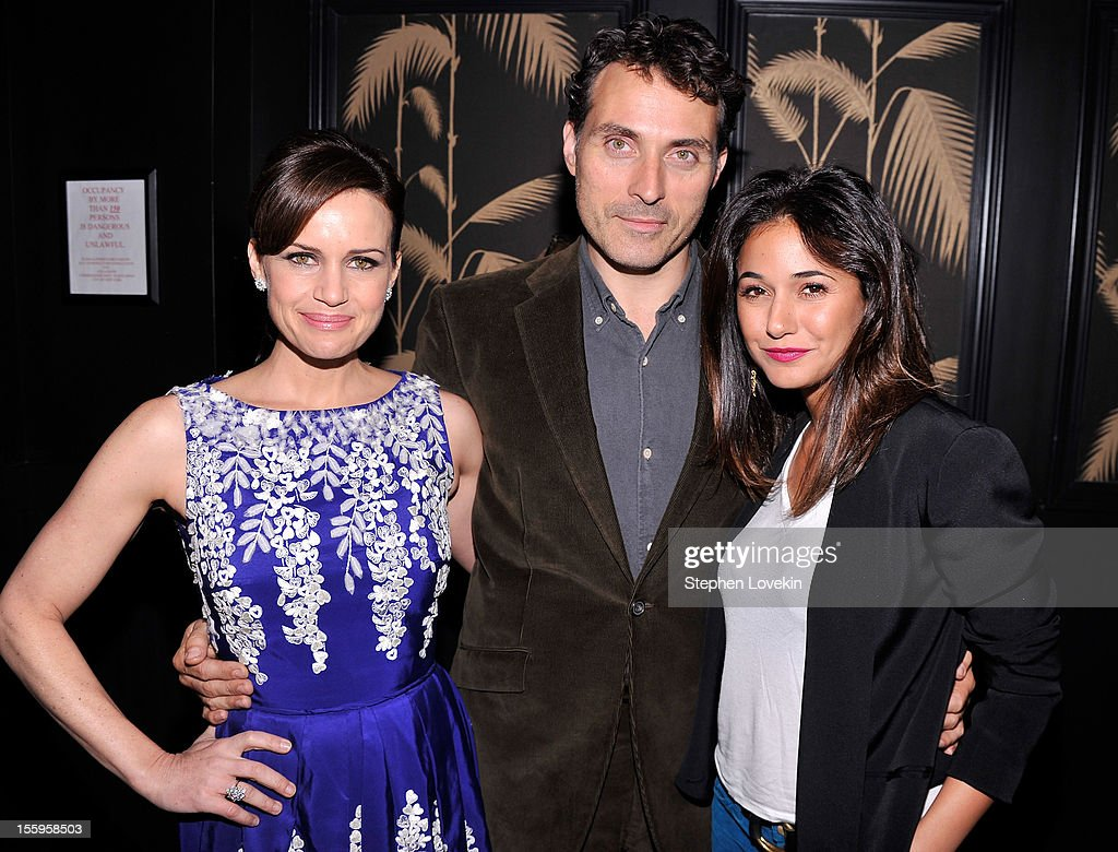 Actors <a gi-track='captionPersonalityLinkClicked' href=/galleries/search?phrase=Carla+Gugino&family=editorial&specificpeople=207137 ng-click='$event.stopPropagation()'>Carla Gugino</a>, <a gi-track='captionPersonalityLinkClicked' href=/galleries/search?phrase=Rufus+Sewell&family=editorial&specificpeople=558279 ng-click='$event.stopPropagation()'>Rufus Sewell</a>, and <a gi-track='captionPersonalityLinkClicked' href=/galleries/search?phrase=Emmanuelle+Chriqui&family=editorial&specificpeople=541098 ng-click='$event.stopPropagation()'>Emmanuelle Chriqui</a> attend the after party for a screening Of 'Hotel Noir' hosted by The Cinema Society and Gato Noir at No. 8 on November 9, 2012 in New York City.