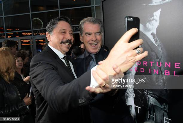 Actors Carlos Bardem left and Pierce Brosnan attend AMC's 'The SON' premiere at ArcLight Hollywood on April 3 2017 in Hollywood California
