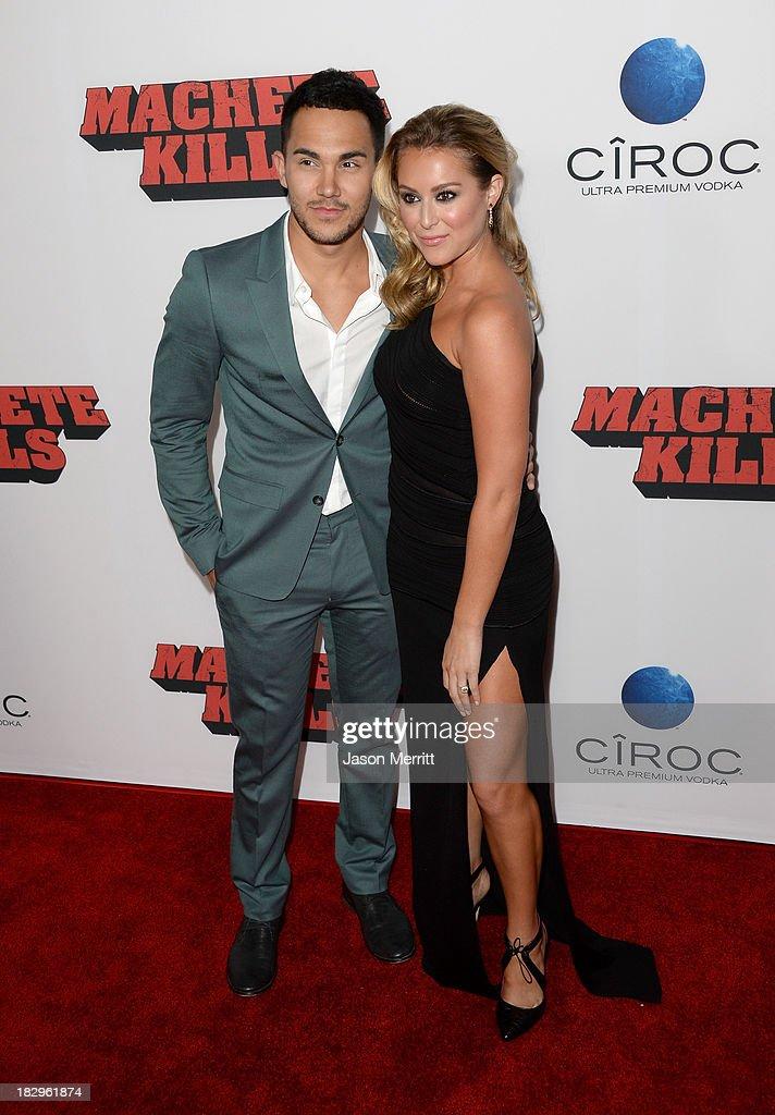 Actors Carlos Pena, Jr and Alexa Vega arrive at the premiere of Open Road Films' 'Machete Kills' at Regal Cinemas L.A. Live on October 2, 2013 in Los Angeles, California.