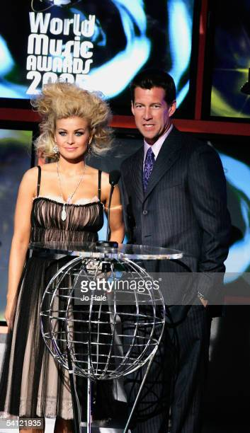 Actors Carmen Electra and James Denton cohost on stage at the 2005 World Music Awards at the Kodak Theatre on August 31 2005 in Hollywood California