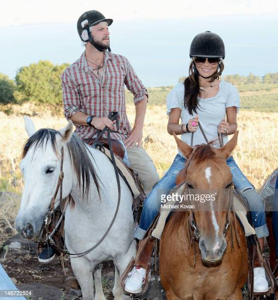 Actors Carmine Giovinazzo and Vanessa Marcil ride horses on June 2 2012 in Vered Hagalil Israel