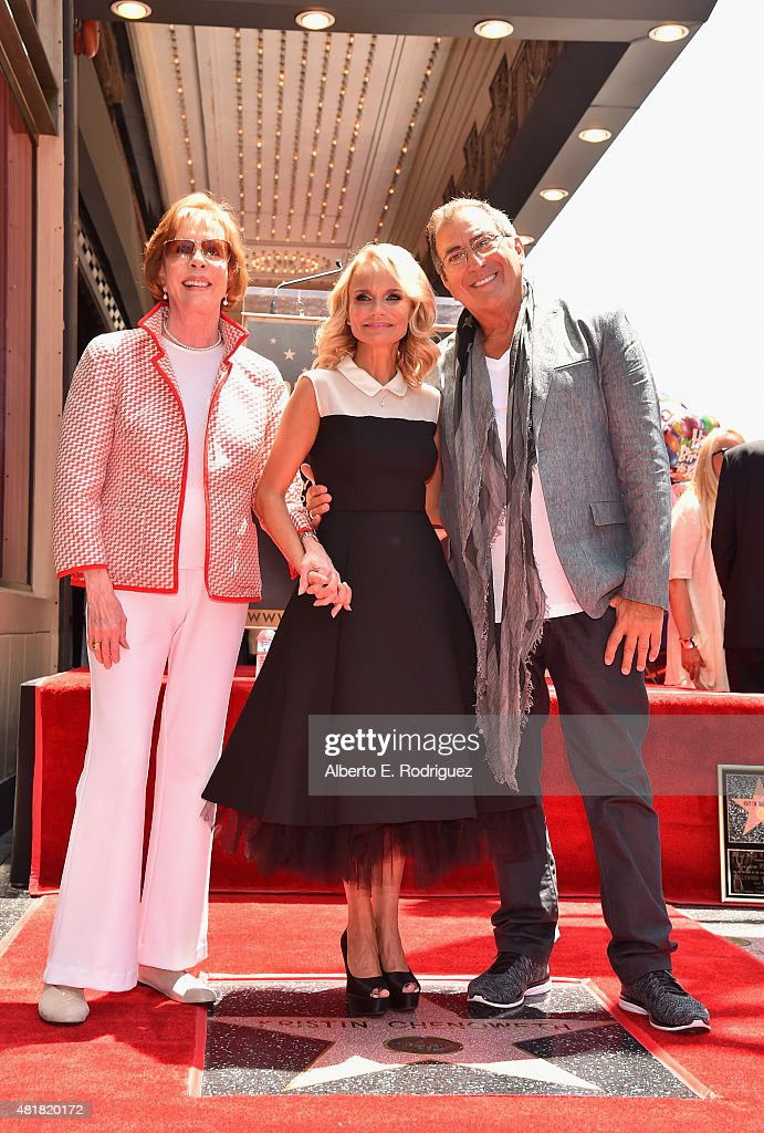 Actors Carol Burnett, Kristin Chenoweth and director Kenny Ortega attend a ceremony honoring Kristin Chenoweth with the 2,555th star on the Hollywood Walk of Fame on July 24, 2015 in Hollywood, California.