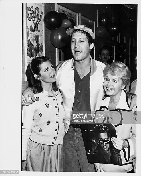 Actors Carrie Fisher Chevy Chase and Debbie Reynolds at a Halloween party at Rehearsal Studios North Hollywood CA October 31st 1980