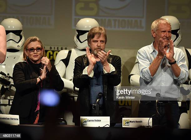 Actors Carrie Fisher Mark Hamill and Harrison Ford applaud onstage at the Lucasfilm panel during ComicCon International 2015 at the San Diego...