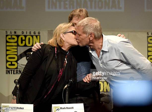 Actors Carrie Fisher Mark Hamill and Harrison Ford pose onstage at the Lucasfilm panel during ComicCon International 2015 at the San Diego Convention...