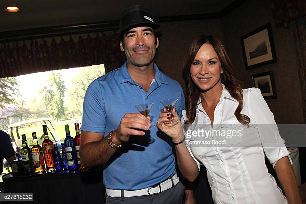 Actors Carter Oosterhouse and Debbe Dunning attend the Backstage Creations Retreat At George Lopez's Celebrity Golf Classic held at Lakeside Golf...