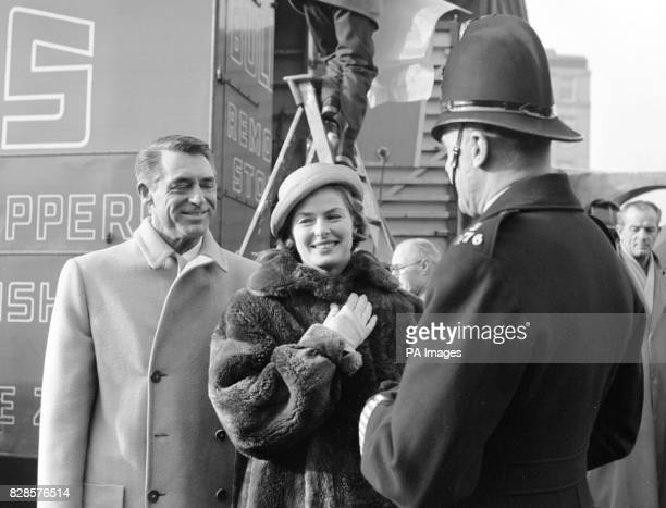Actors Cary Grant and Ingrid Bergman finding time to chat with PC Sid Goodwin as he passed on his beat while they were shooting street scenes for...