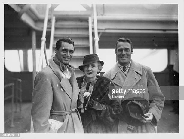Actors Cary Grant Randolph Scott And Virginia Cherrill aboard the SS Pars on its arrival at Plymouth England November 24th 1933