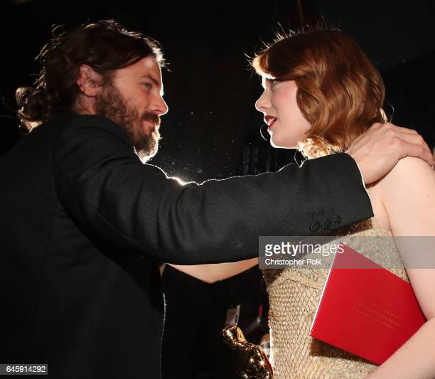 Actors Casey Affleck and Emma Stone greet backstage during the 89th Annual Academy Awards at Hollywood Highland Center on February 26 2017 in...