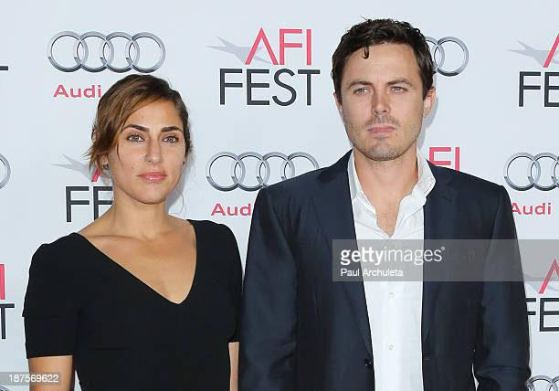 Actors Casey Affleck and his wife Summer Phoenix attend the 'Out Of The Furnace' premiere at AFI FEST 2013 at the TCL Chinese Theatre on November 9...