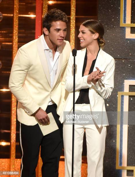 Actors Casey Moss and Kate Mansi speak onstage during The 41st Annual Daytime Emmy Awards at The Beverly Hilton Hotel on June 22 2014 in Beverly...