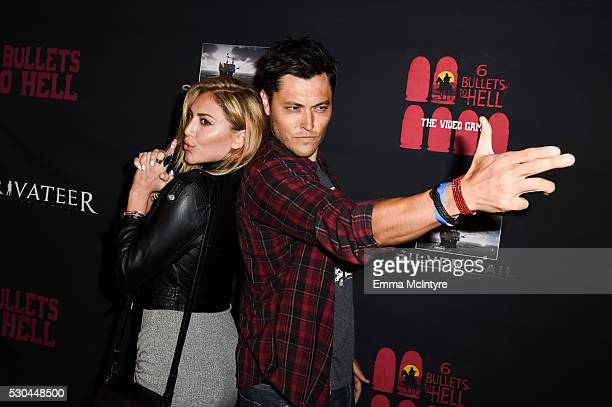 Actors Cassie Scerbo and Blair Redford attend the launch of '6 Bullets to Hell' on May 10 2016 in Los Angeles California