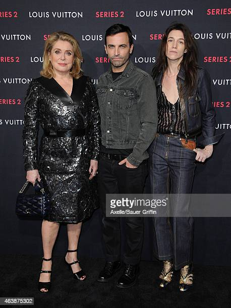 Actors Catherine Deneuve Charlotte Gainsbourg and designer Nicolas Ghesquiere arrive at Louis Vuitton 'Series 2' The Exhibition on February 5 2015 in...