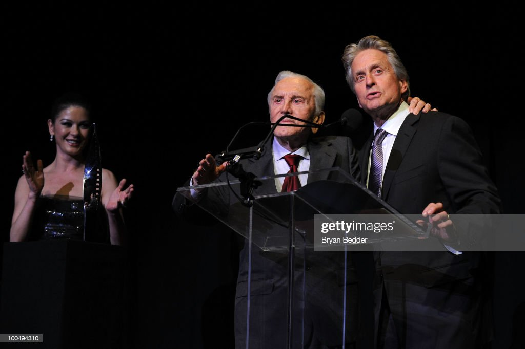 Actors Catherine Zeta Jones and Kirk Douglas present Michael Douglas with a award at the The Film Society of Lincoln Center's 37th Annual Chaplin Award gala at Alice Tully Hall on May 24, 2010 in New York City.