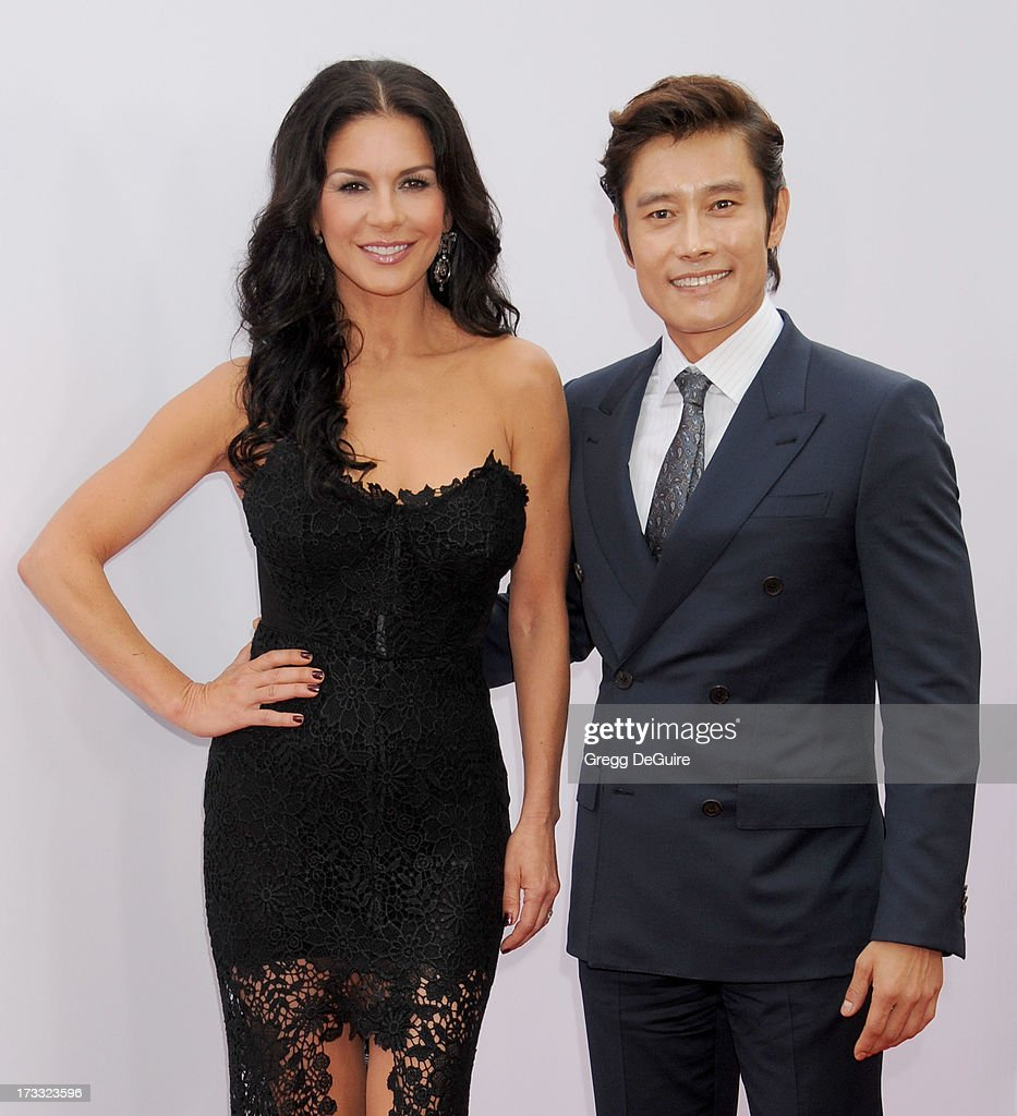 Actors <a gi-track='captionPersonalityLinkClicked' href=/galleries/search?phrase=Catherine+Zeta-Jones&family=editorial&specificpeople=167111 ng-click='$event.stopPropagation()'>Catherine Zeta-Jones</a> and Byung-hun Lee arrive at the Los Angeles premiere of 'Red 2' at Westwood Village on July 11, 2013 in Los Angeles, California.