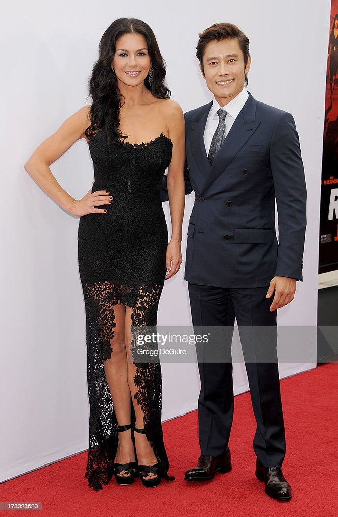 Actors Catherine Zeta-Jones and Byung-hun Lee arrive at the Los Angeles premiere of 'Red 2' at Westwood Village on July 11, 2013 in Los Angeles, California.