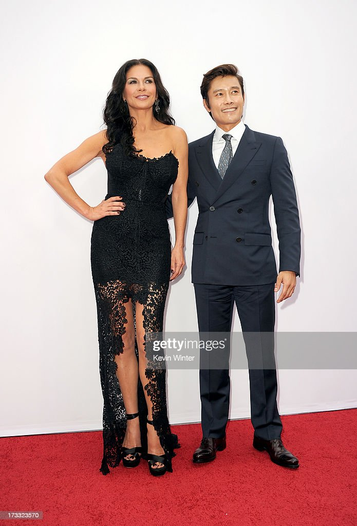 Actors Catherine Zeta-Jones (L) and Byung-hun Lee attend the premiere of Summit Entertainment's 'RED 2' at Westwood Village on July 11, 2013 in Los Angeles, California.