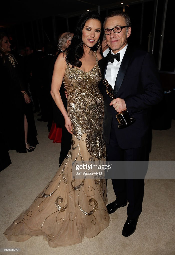 Actors Catherine Zeta-Jones (L) and Christoph Waltz attend the 2013 Vanity Fair Oscar Party hosted by Graydon Carter at Sunset Tower on February 24, 2013 in West Hollywood, California.
