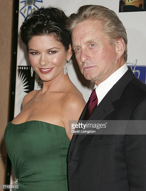 Actors Catherine ZetaJones and husband Michael Douglas arrive for the third annual 'A Fine Romance' an evening of celebrity performances honoring...